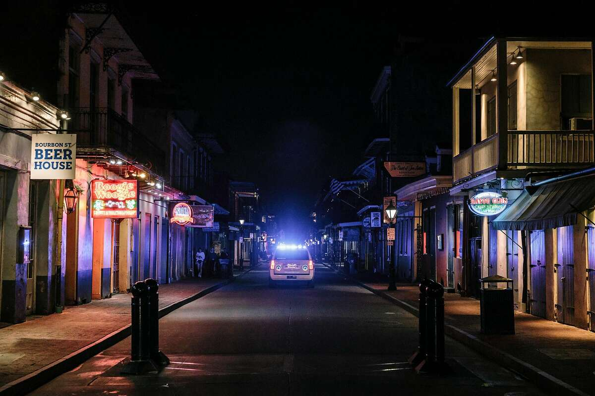 A deserted Bourbon Street in New Orleans, March 18, 2020. Louisiana may be experiencing the world's fastest growth in new cases of the coronavirus. Medical experts said Mardi Gras might have accelerated the crisis. (William Widmer/The New York Times)