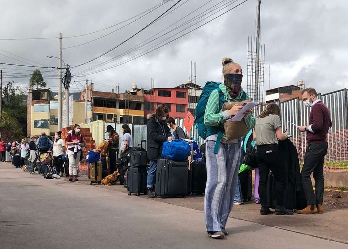 Passengers wait to board a flight out of Cusco.