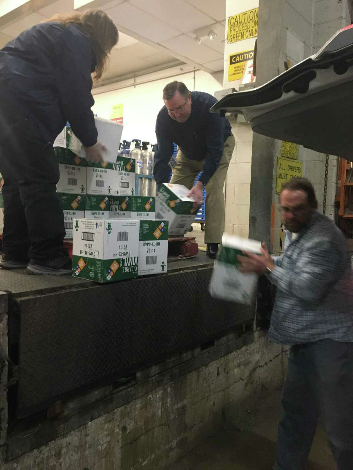 Foxwoods employees load safety supplies into a truck for three eastern Connecticut health facilities recently.