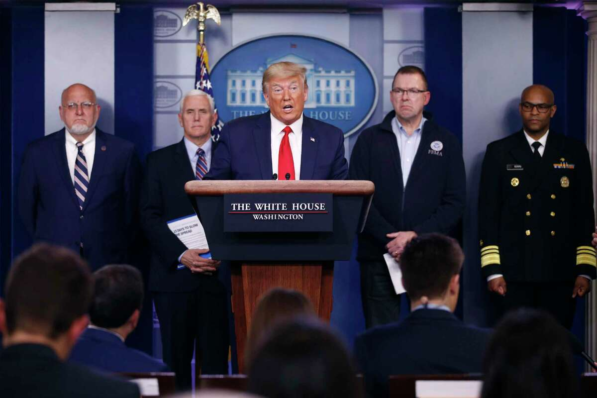 President Donald Trump speaks during a coronavirus task force briefing at the White House March 22. Standing behind Trump are Dr. Robert Redfield, director of the Centers for Disease Control and Prevention, from left, Vice President Mike Pence, FEMA administrator Peter Gaynor and U.S. Surgeon General Jerome Adams.