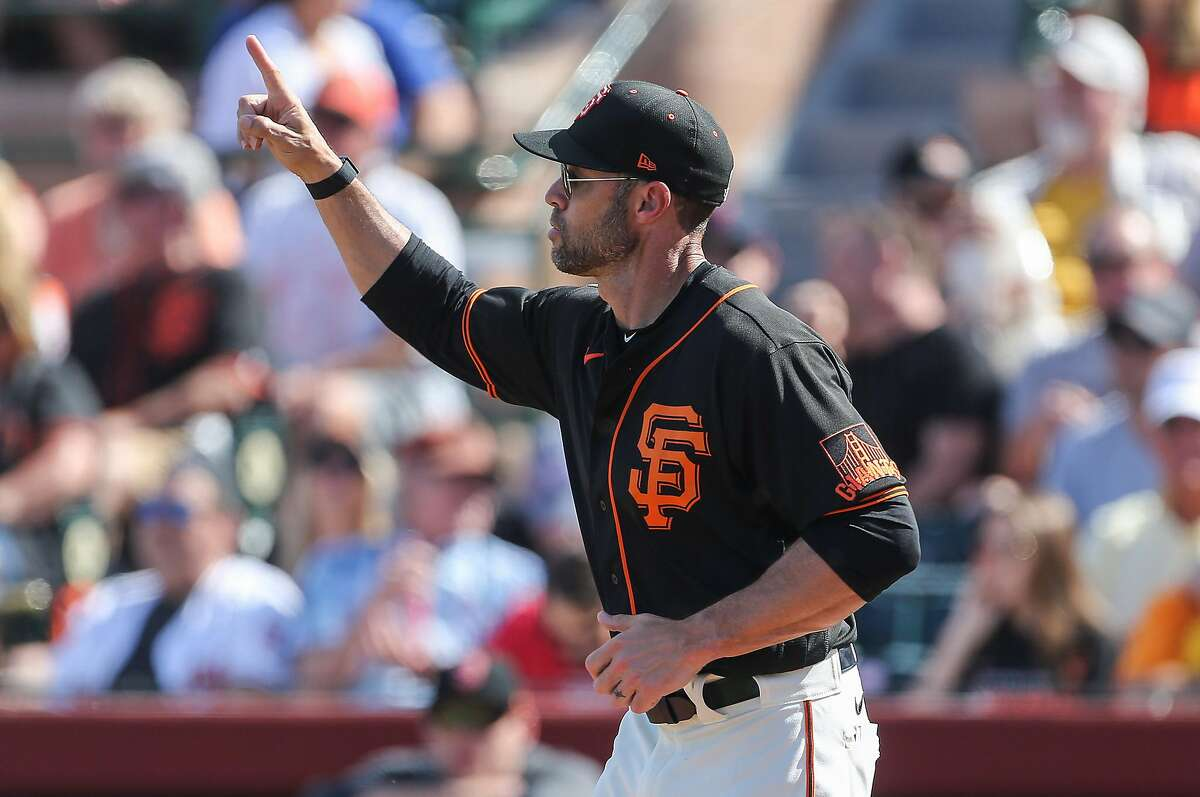 San Francisco Giants' head coach Gabe Kapler signals the bullpen for a righty during their game with the Cleveland Indians at Scottsdale Stadium Thursday, March 5, 2020, in Scottsdale, Arizona.