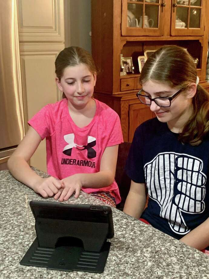 Co-presenters of the coronavirus youth webinar and Norwalk students Audra and Alexa Lacomis at their Norwalk, CT, home. Photo: Contributed
