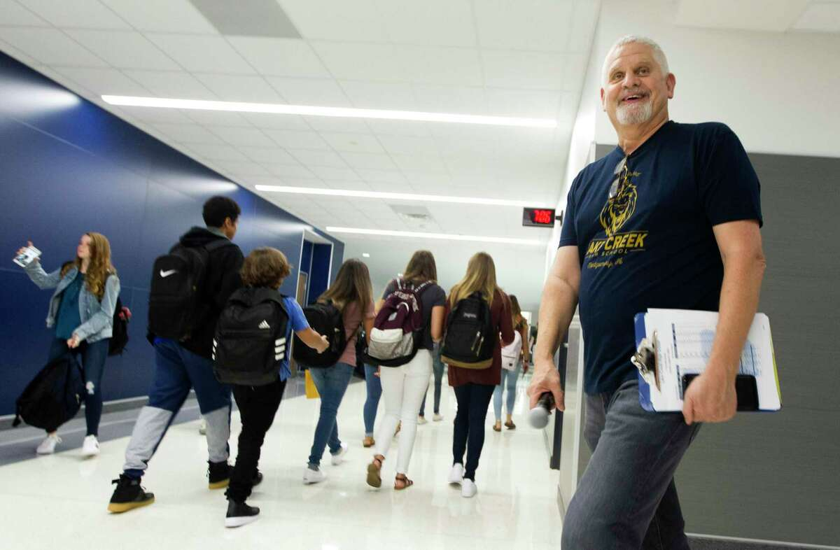 Lake Creek Principal Phil Eaton shares a laugh as students walk the hallway on the first day of school for Montgomery ISD's new Lake Creek High School on Tuesday, Aug. 21, 2018, in Montgomery.