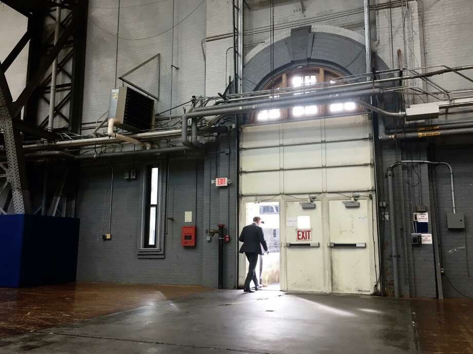 Gov. Ned Lamont leaves the Gov. William A. O'Neill State Armory gymnasium in Hartford, Conn. March 20, 2020. After announcing the state's fourth COVID-19 fatality, a Norwalk woman in her 80s, Gov. Ned Lamont an order on Friday that non-essential workers, public and private, stay home to promote social distancing and slow the spread of the coronavirus. Photo: Dan Haar / Hearst Connecticut Media