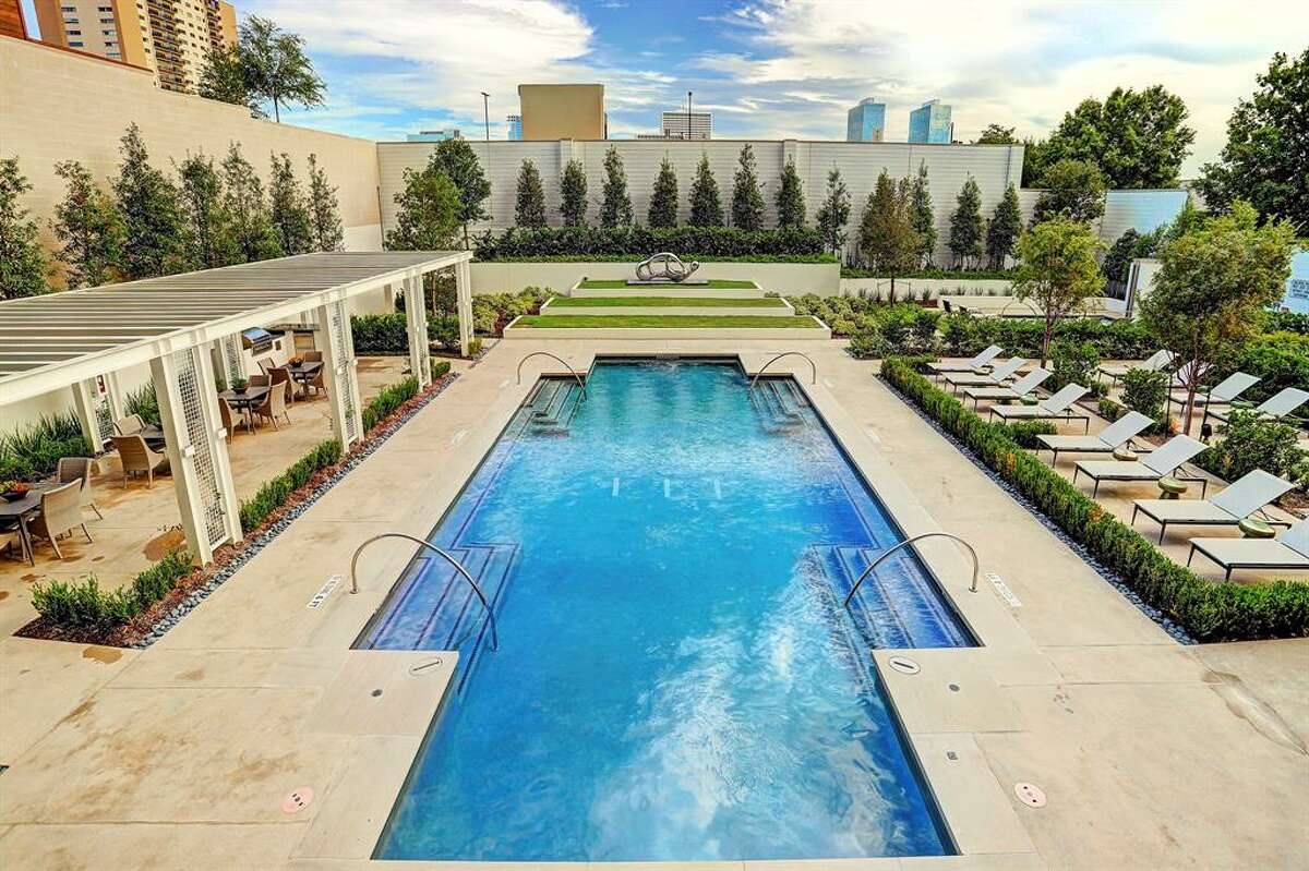 Building amenities include two resort-style pools, a pet grooming spa and dog park, fitness center, yoga room, massage therapy room, catering kitchen, valet parking and concierge.