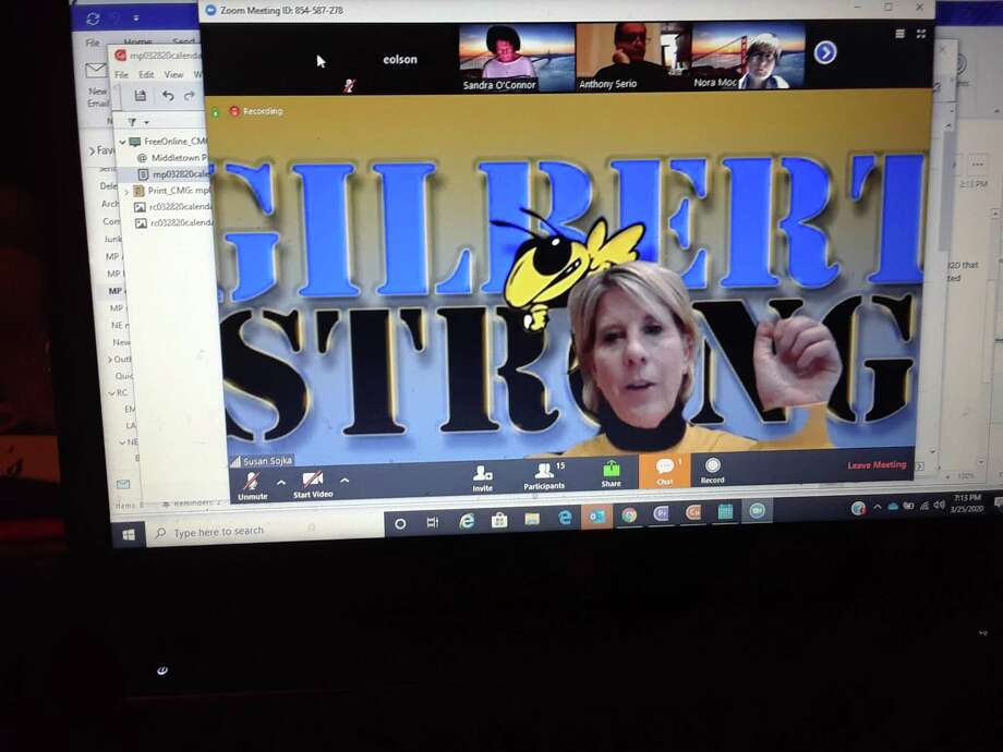 "Members of the Gilbert School Corp. met Wednesday night online. Above, Gilbert School Principal Susan Sojka, showing a ""Gilbert Strong"" desktop behind her, discusses distance learning with the board. Photo: Emily M. Olson / Hearst Connecticut Media"