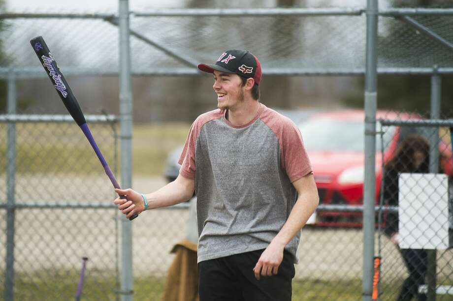 d'Artagnan Booth, 21, plays softball with friends Thursday, March 26, 2020 at the Redcoats Softball Complex in Midland. (Katy Kildee/kkildee@mdn.net) Photo: (Katy Kildee/kkildee@mdn.net)