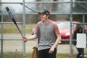 d'Artagnan Booth, 21, plays softball with friends Thursday, March 26, 2020 at the Redcoats Softball Complex in Midland. (Katy Kildee/kkildee@mdn.net)