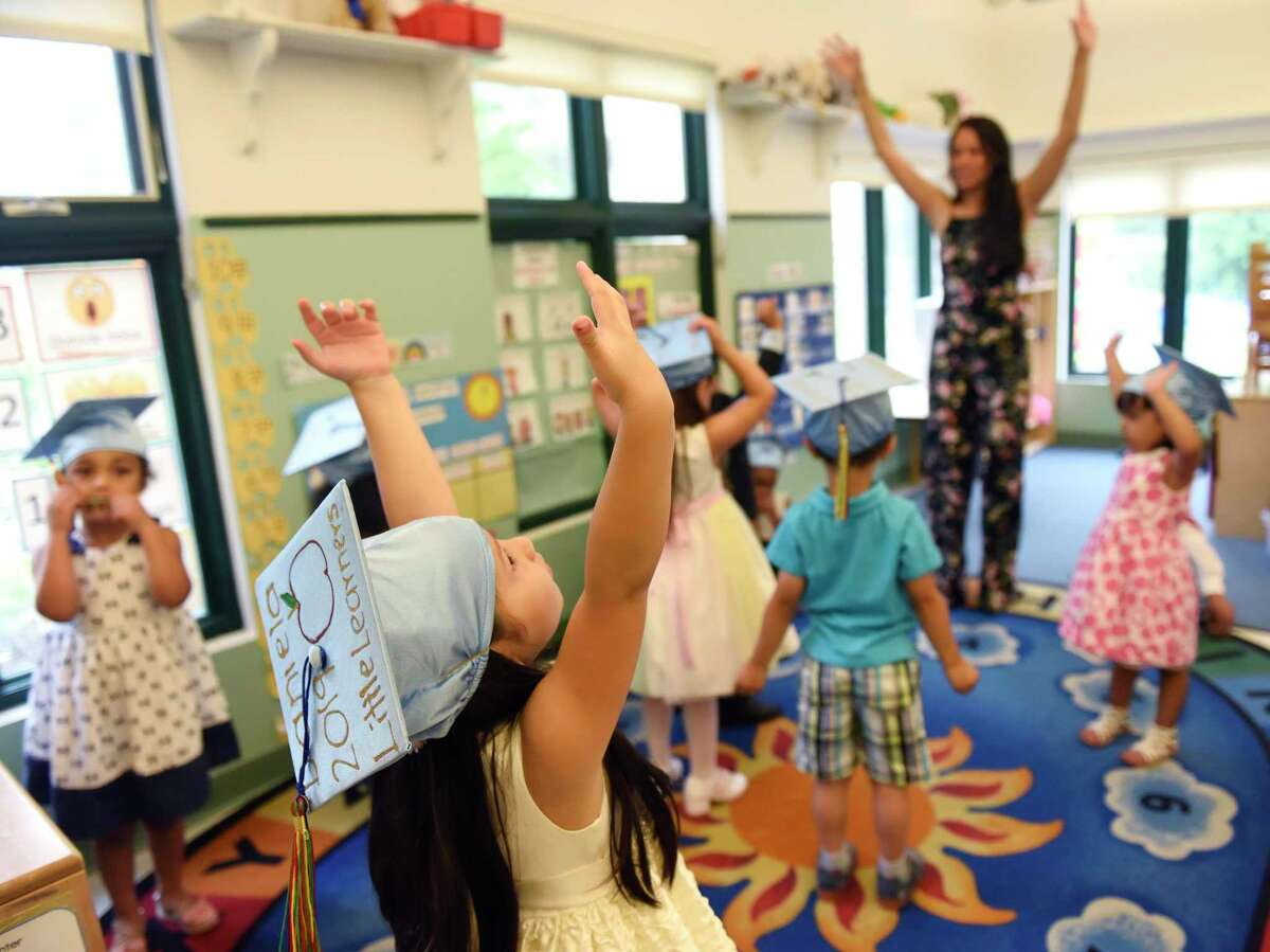 Pre-K student Daniela Roldan stretches out with her class before the Family Centers Head Start preschool graduation ceremony at Armstrong Court in the Chickahominy section of Greenwich in June 2019. Family Centers is teaming with the Stamford Advocate and Greenwich Time, along with three other local nonprofits, to raise money to help neighbors suffering consequences of the pandemic.