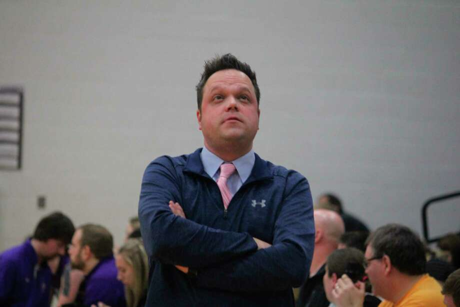 CCA's Jason Kostecki, pictured at a basketball game this season is also the school's baseball coach. (Pioneer file photo/John Raffel)