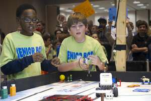 Mississippi students monitor their robots during the 2012 FIRST LEGO League Mississippi Championship Tournament in Hattiesburg, Miss.