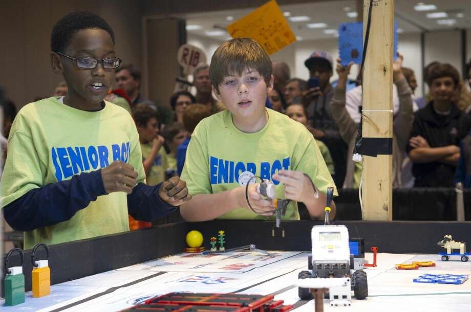 Mississippi students monitor their robots during the 2012 FIRST LEGO League Mississippi Championship Tournament in Hattiesburg, Miss. Photo: NASA