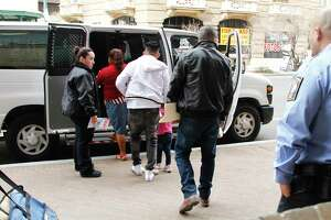 Immigration detention guards flank asylum seekers as they leave court under guard  in El Paso in February. As the pandemic spreads, the federal government is keeping scores of people cheek by jowl in facilities that have been well-documented to be lacking in proper ventilation, food or even clean, running water.