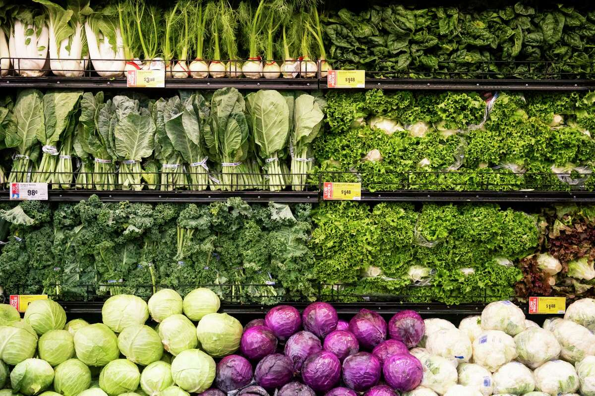 Organic produce is lined up before the store opens Wednesday morning, March 25, 2020, at H-E-B in Bellaire.