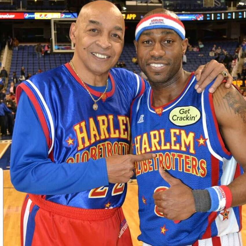 Tay Fisher, right, said Curly Neal taught him to handle the ball like the Harlem Globetrotters great. (Courtesy of Tay Fisher)