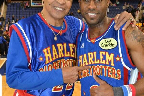 Tay Fisher, right, said Curley Neal taught him to handle the ball like the Harlem Globetrotters great. (Courtesy of Tay Fisher)