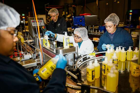 Employees work at the EO factory on Monday, March 23, 2020 in San Rafael, California. They have seen the need for their product grow by over 1000% in the last month.