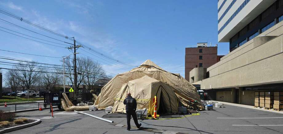 A 25 bed mobile field hospital was erected outside Danbury Hospital on Wednesday. Thursday, March 26, 2020, in Danbury, Conn. Photo: H John Voorhees III / Hearst Connecticut Media / The News-Times