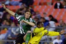 Colorado Rapids defenseman Chris Martinez, left, collides with Columbus Crew forward John DeBrito as they battle for the ball in the second half of a Major League Soccer contest in 2000.
