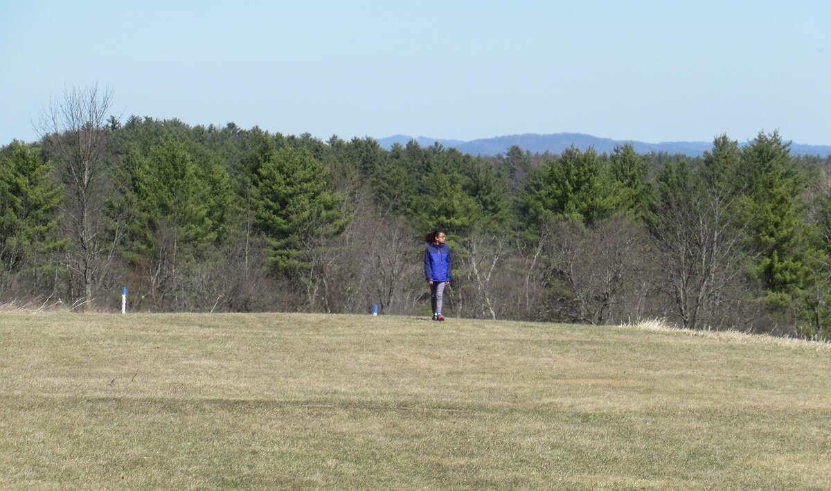 Herb Terns' daughter Little Wren walks near the Neilson Farm at the Saratoga Battlefield. (Herb Terns / Times Union)