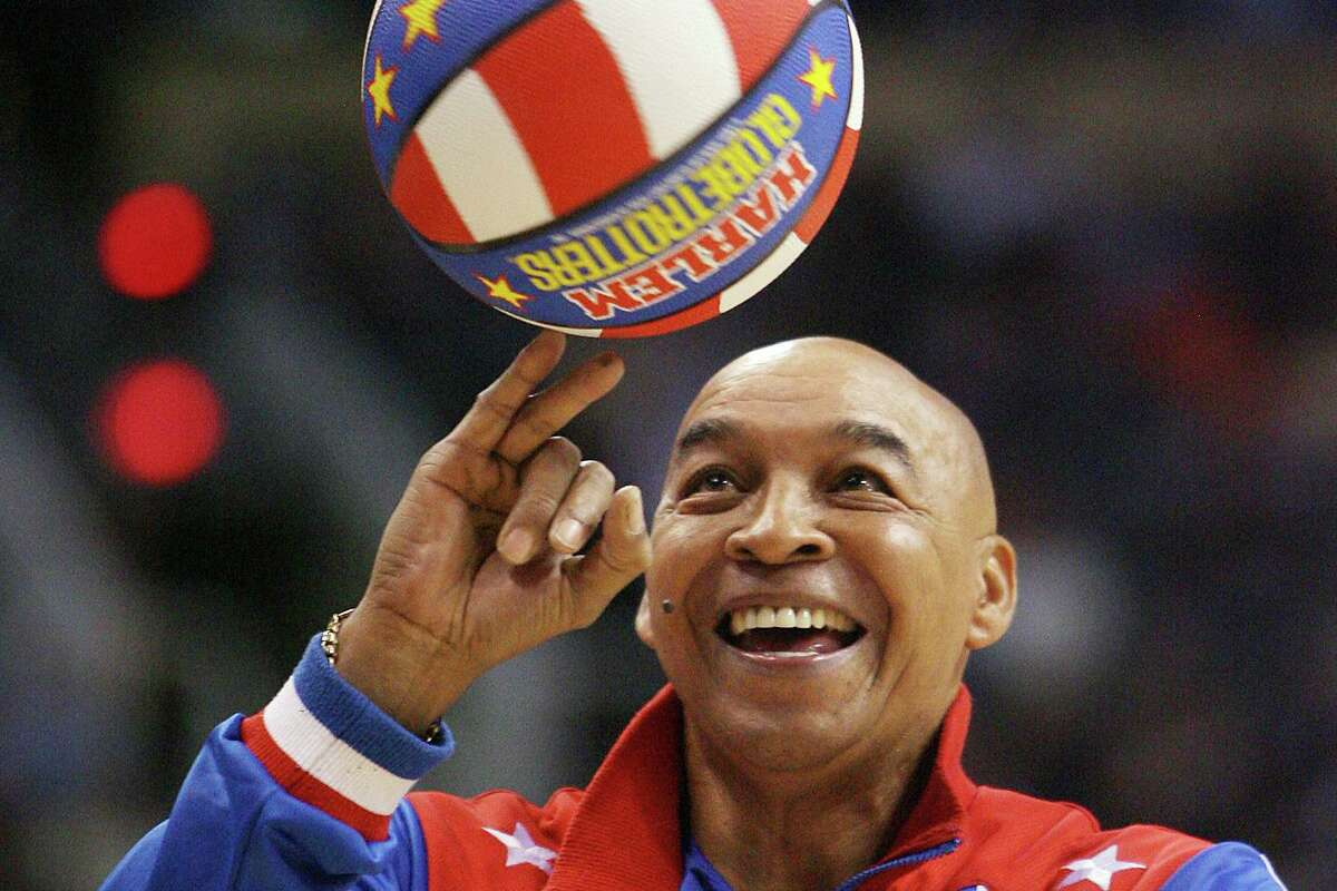 """Harlem Globetrotters' Fred """"Curly"""" Neal, the dribbling wizard who entertained millions with the Harlem Globetrotters for parts of three decades, has died the Globetrotters announced Thursday, March 26, 2020. He was 77. Neal played for the Globetrotters from 1963-85, appearing in more than 6,000 games in 97 countries for the exhibition team known for its combination of comedy and athleticism."""