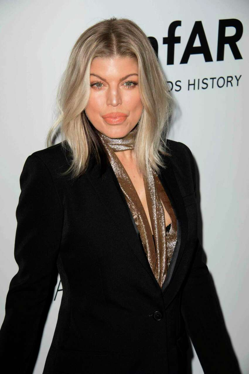 Singer Fergie attends the amfAR Gala Los Angeles honoring actress Julia Roberts on October 13, 2017 in Beverly Hills, California. / AFP PHOTO / VALERIE MACONVALERIE MACON/AFP/Getty Images ORG XMIT: 1