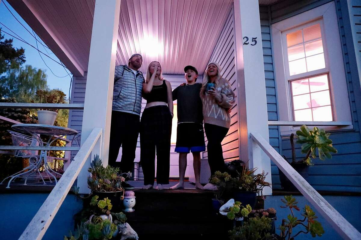 """The Smart family- Shay, Samantha, Cameron and Charity- take part in the nightly """"Howl at the Moon"""" at 8pm in Mill Valley, Calif., on Tuesday, March 24, 2020."""