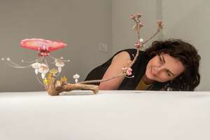 Mariah Rockefeller, Curator of Exhibitions & Collections at the Art Museum of Southeast Texas  takes a closer look at an art piece in Kana Harada's Celestial Garden collection. Photographed on March 20, 2020. Fran Ruchalski/The Enterprise