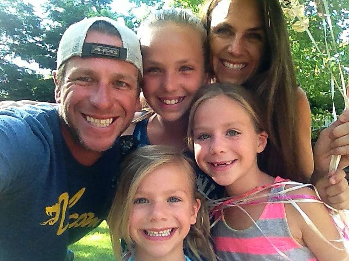 A�s West Coast scouting supervisor Scott Kidd, his wife Gina and his three daughters