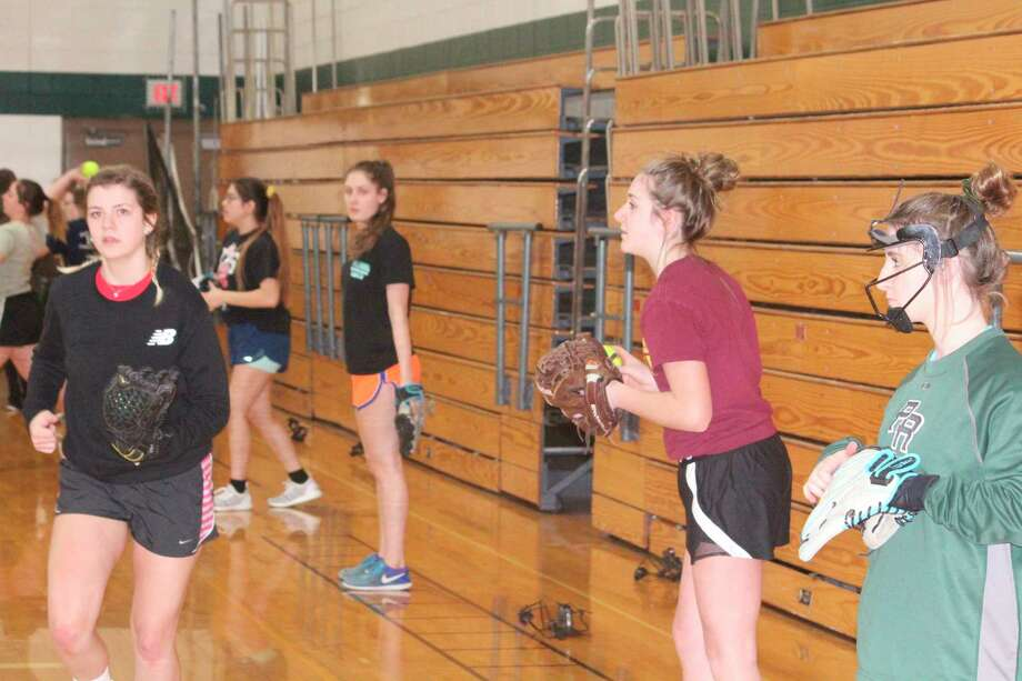 Pine River's Cayla Trowbridge (left) and her teammates practice on March 13 prior to the suspension of the spring sports season. (Pioneer photo/John Raffel)