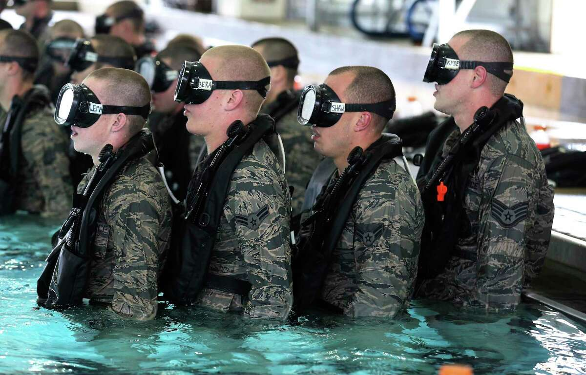 Air Force personnel stand at attention while awaiting orders during Pararescue Traning for water confidence at Joint Base San Antonio-Lackland in 2018. Coronavirus concerns have prompted commanders to prepare an alternate site for basic training at Keesler AFB in Biloxi, Mississippi, to open April 7. (Kin Man Hui/San Antonio Express-News)