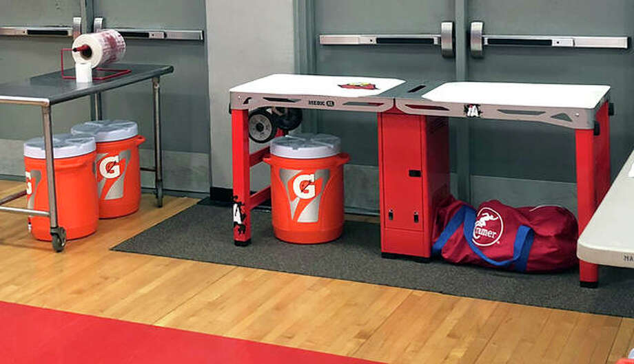 The athletic training table of Alton High athletic trainer Andy Renner, along with equipment, water and ice, sits ready to take to a Redbirds sports event. Photo: Submitted Photo