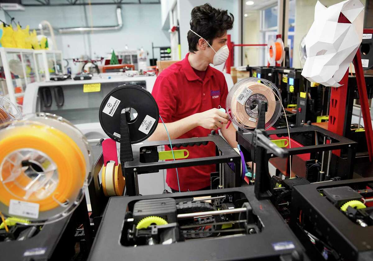 Ahmet Karagoz, an alumnus and intern at Harmony Public Schools, works with 3D printer for face shield parts in the school's Innovation Lab in Southwest Houston on Thursday, March 26, 2020. The face shields are going to be donated to local medical workers as shortages of vital medical supplies complicate efforts to help treat patients with COVID-19.