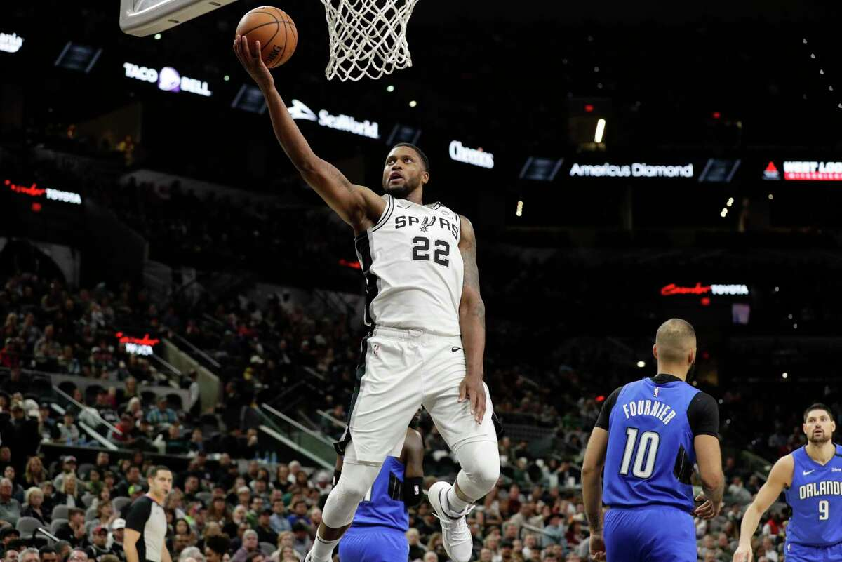 San Antonio Spurs forward Rudy Gay (22) drives to the basket against the Orlando Magic during the first half of an NBA basketball game in San Antonio, Saturday, Feb. 29, 2020. (AP Photo/Eric Gay)