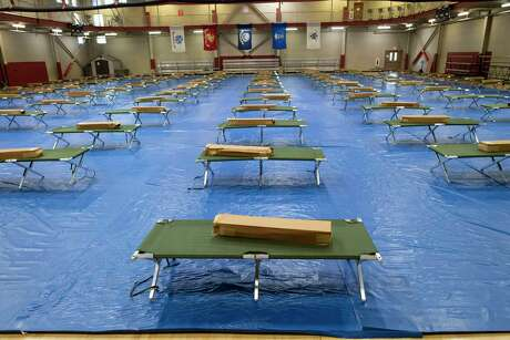 A gym at JBSA-Fort Sam Houston has been equipped with cots to quarantine military personnel who show COVID-19 symptoms while they await test results. Several similar sites are being prepared at the post and at JBSA-Lackland and -Randolph.