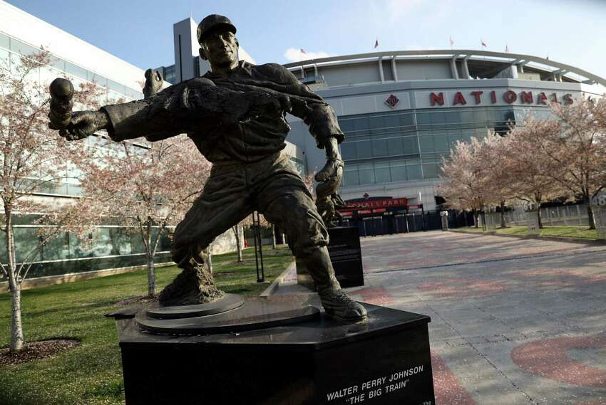 WASHINGTON, - MARCH 26: The statue of Hall of Fame pitcher Walter Johnson is shown outside Nationals Park, home to the World Series Champion Washington Nationals, which is empty on the scheduled date for Opening Day March 26, 2020 in Washington, DC. Major League Baseball has postponed the start of its season due to the COVID-19 outbreak and MLB commissioner Rob Manfred recently said the league is