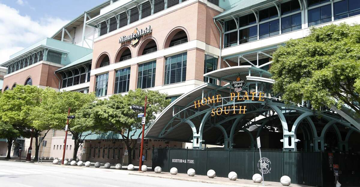 """Exterior of Minute Maid Park, in Houston,Thursday, March 12, 2020. MLB announced today that spring training for all teams including the Houston Astros would be suspended, and they would delay the start of the regular season """"by at least two weeks"""" amid country-wide cancellations due to the coronavirus pandemic."""
