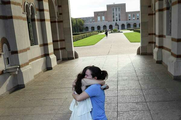 """Alessi Armengol, right, hugs her roommate of three years Julia Greenberg outside of Lovett Hall on Thursday, March 12, 2020, at Rice University of Houston in Houston. Campus officials announced that classes would move online for the remainder of the semester due to concerns about COVID-19. Both women are seniors. """"It's really sad, Rice has become my home,"""" Greenberg said. """"The people here have been the strongest network for me."""""""