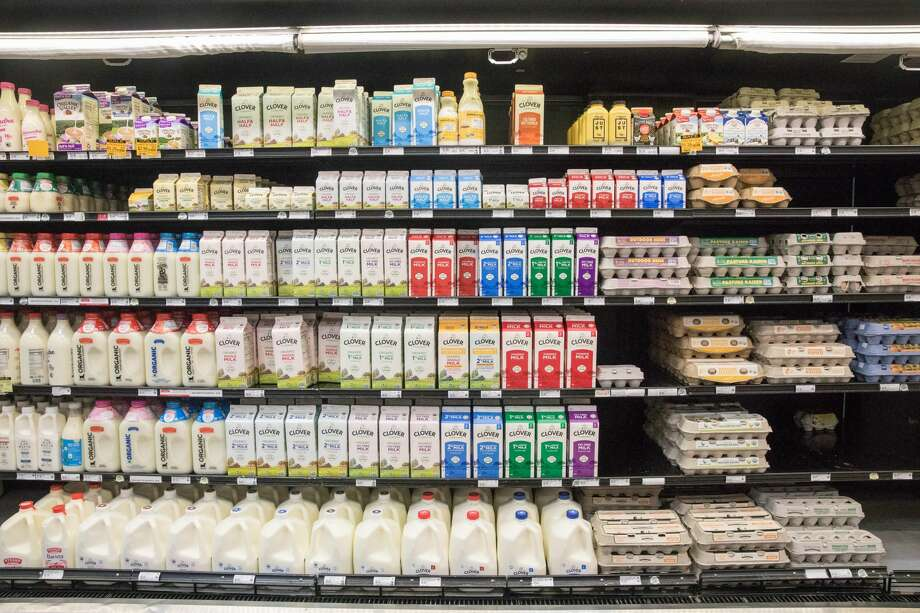 Shelves of milk and eggs have been restocked at Co-Op Rainbow Grocery. The store has put in limits on the amount of customers inside grocery store to promote social distancing and help prevent the spread of the coronavirus in San Francisco, Calif. on March 26, 2020. Photo: Douglas Zimmerman/SFGate / SFGate