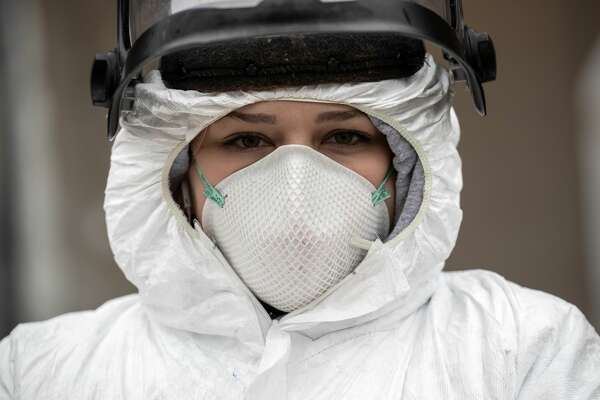 STAMFORD, CT - MARCH 23: Nurse Hannah Sutherland, dressed in personal protective equipment (PPE) awaits new patients at a drive-thru coronavirus testing station at Cummings Park on March 23, 2020 in Stamford, Connecticut. Availability of protective clothing for medical workers has become a major issue as COVID-19 cases surge throughout the United States. The Stamford site is run by Murphy Medical Associates. (Photo by John Moore/Getty Images)