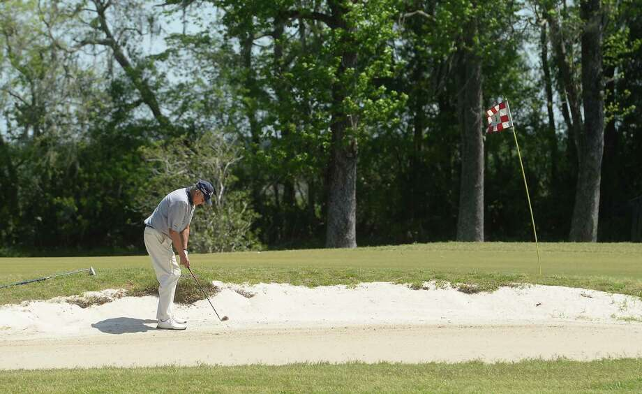 A golfer plays a solo round at Homberg Municipal Golf Course in Tyrrell Park Thursday.   Photo taken Thursday, March 26, 2020 Kim Brent/The Enterprise Photo: Kim Brent / The Enterprise / BEN
