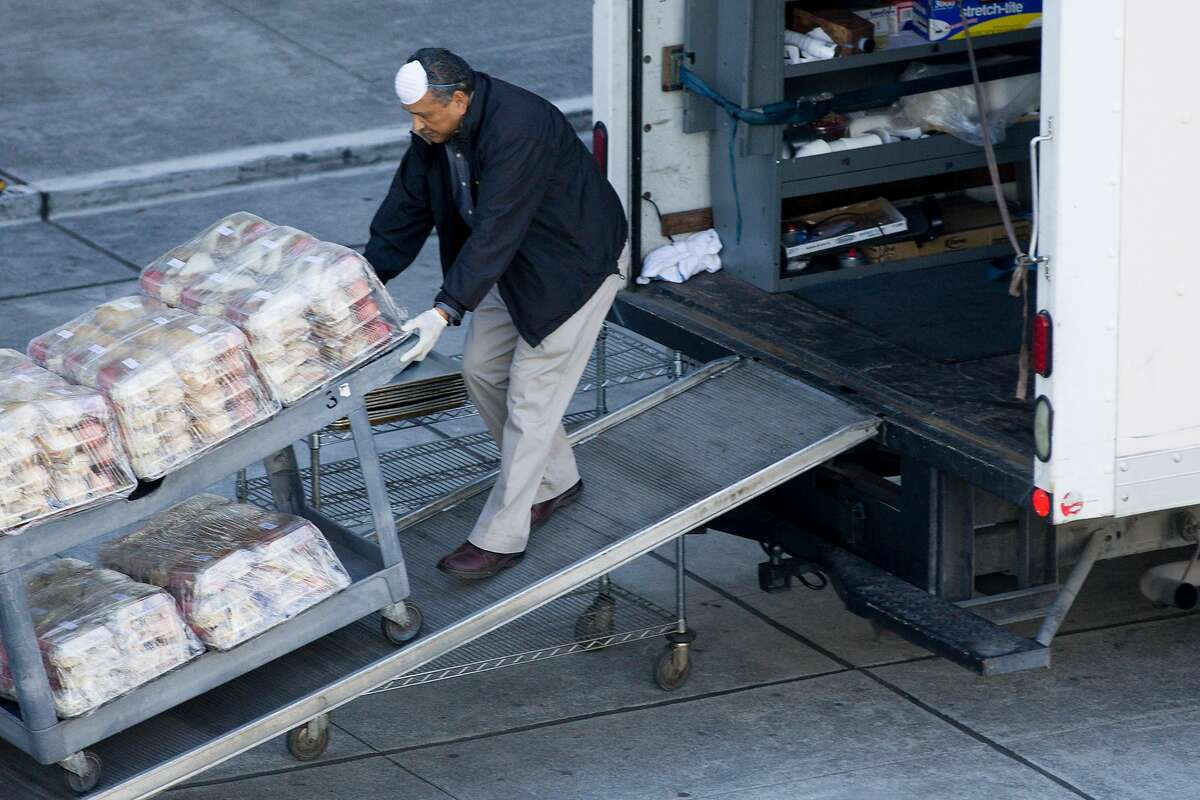 A man transports coffee and food for various San Francisco city departments in Moscone Center on Howard Street in San Francisco, Calif. Thursday, March 26, 2020. San Francisco is currently using Moscone Center as their emergency operations center as residents shelter-in-place due to the outbreak of the Coronavirus.