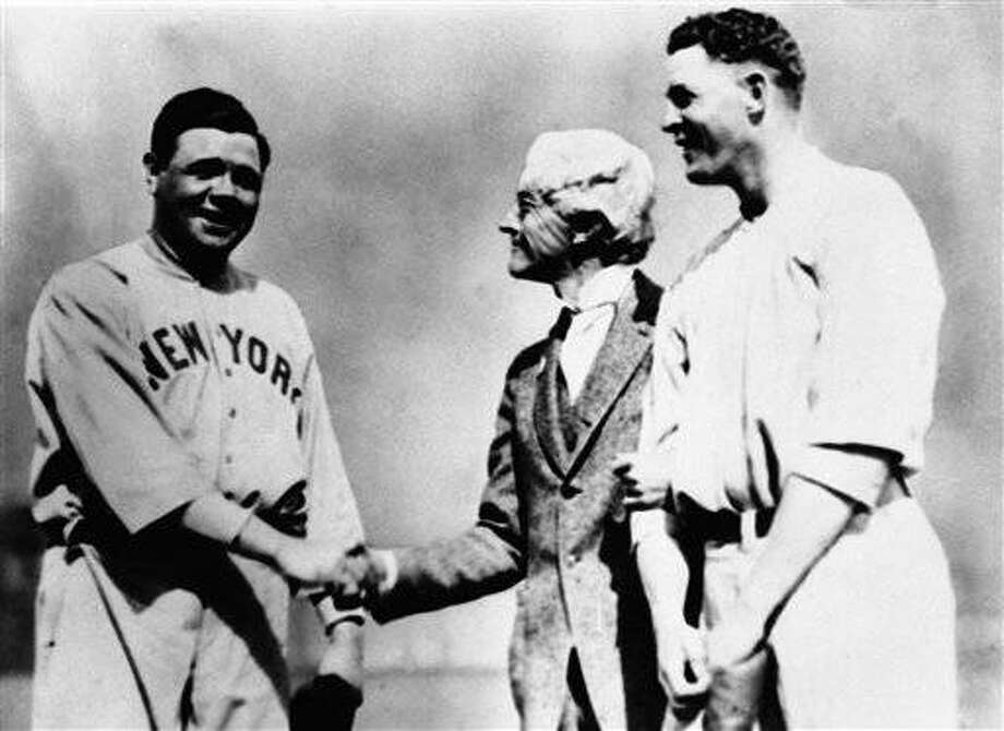 High Commissioner X. M. Landis, greets Babe Ruth and Bob Meusel, Yankees, March 27, 1922, who have been suspended for a month for barnstorming after the world series. (AP Photo)