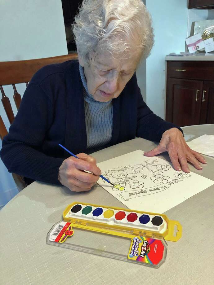 Margaret DePoli from Greenwich enoys watercolors sent to her by the River House Therapeutic Recreation Team. Photo: Contributed Photo