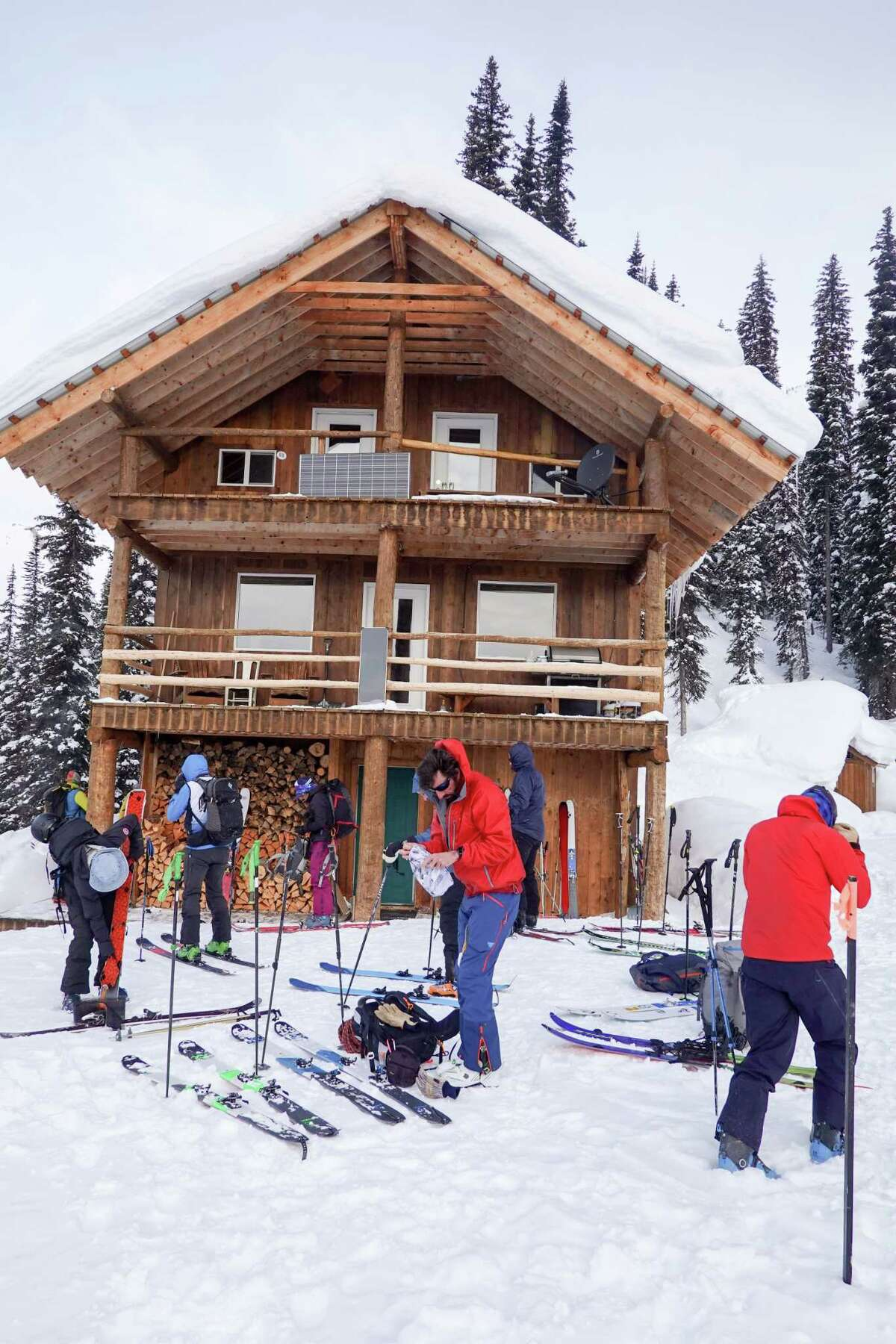 Guests at the Icefall Lodge in British Columbia prepare their ski gear before heading out one morning in March.