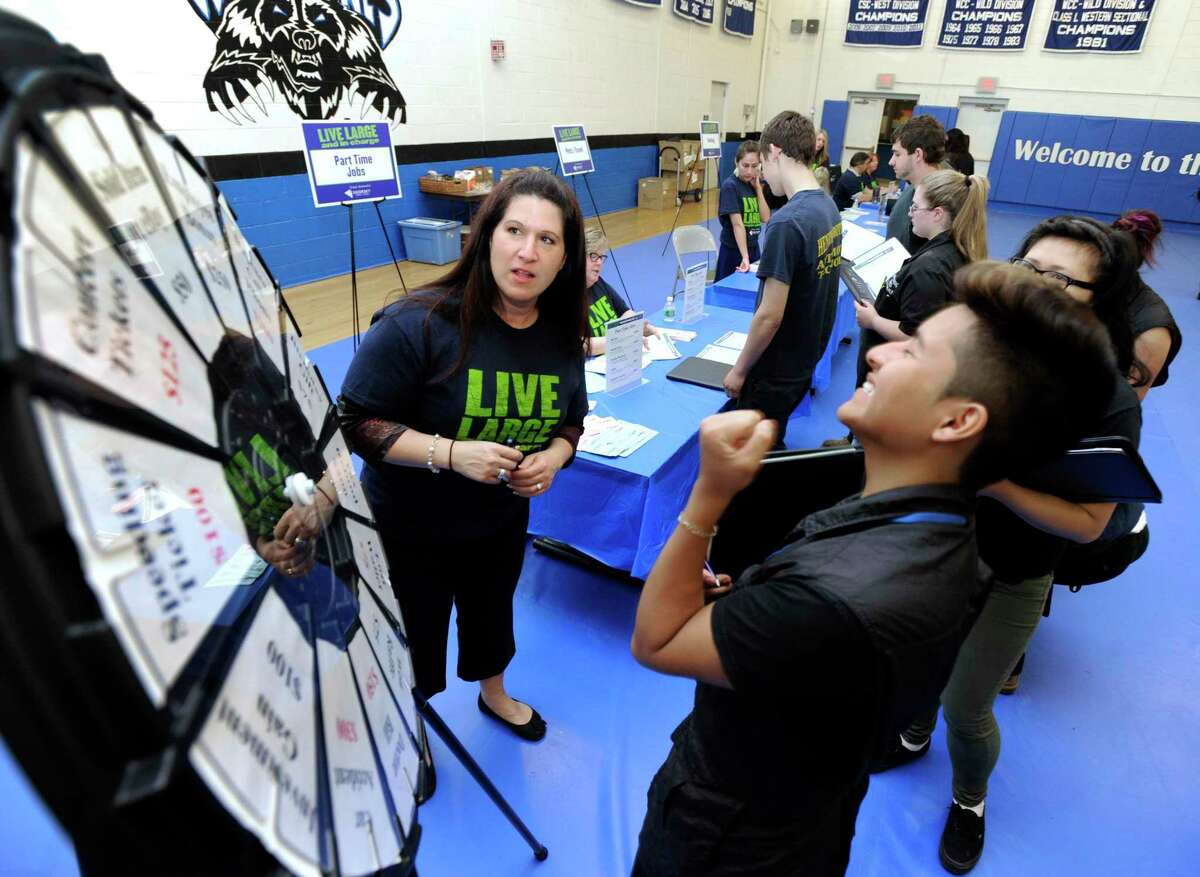 """A file photo of the """"wheel of reality"""" station created by Sikorsky Federal Credit Union employees for a personal finance workshop at Henry Abbott Technical High School in Danbury, Conn."""