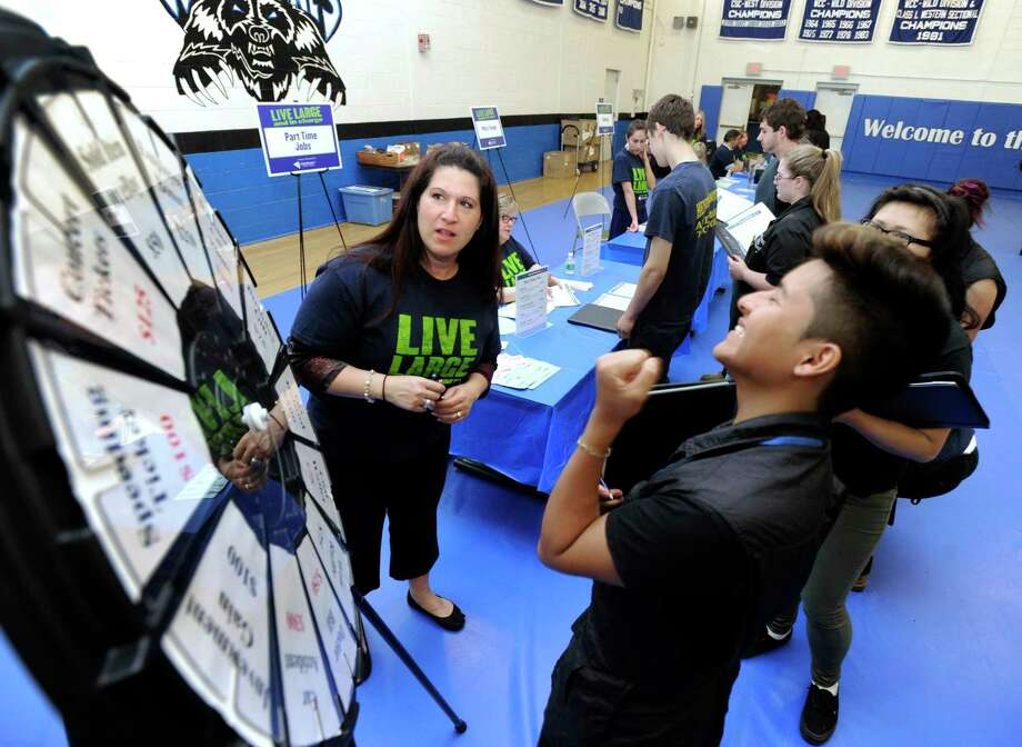 "A file photo of the ""wheel of reality"" station created by Sikorsky Federal Credit Union employees for a personal finance workshop at Henry Abbott Technical High School in Danbury, Conn. Photo: Carol Kaliff / Carol Kaliff / The News-Times"