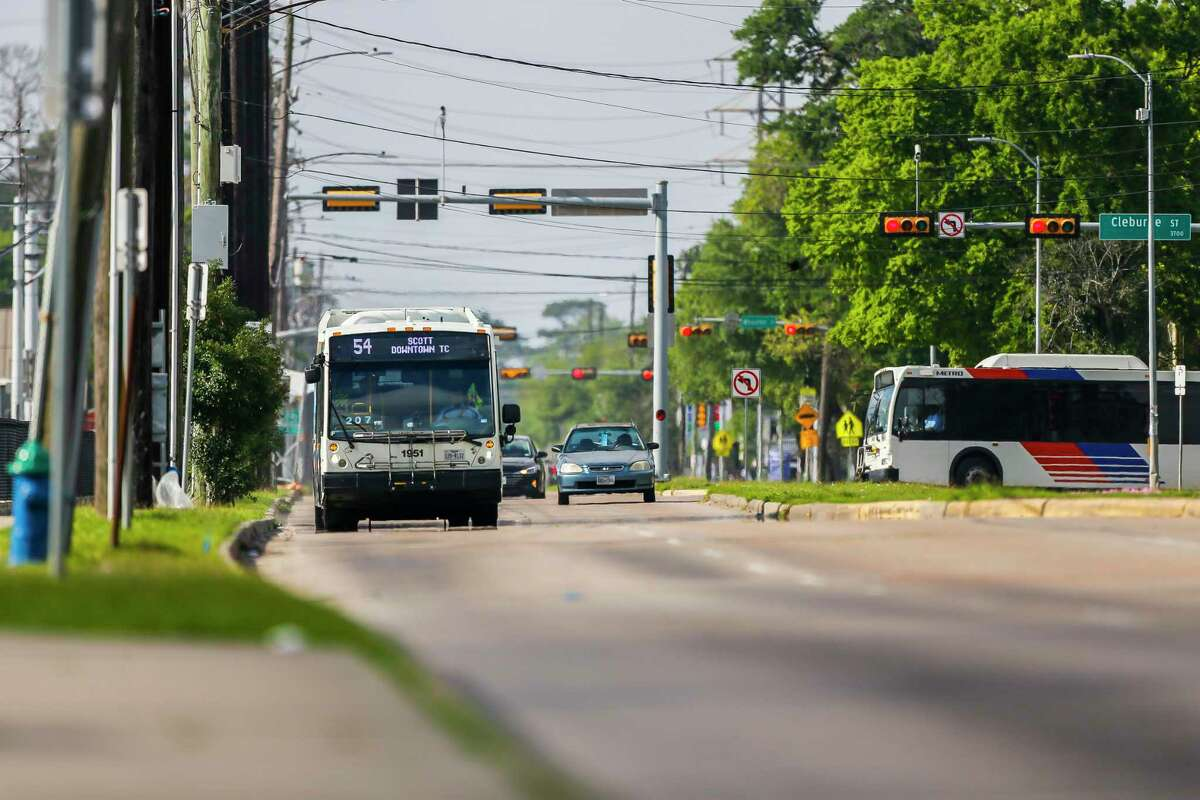 A Route 54 bus travels north up Scott Street on March 26, 2020, near the University of Houston. Metropolitan Transit Authority added Wi-Fi to the route in October and now will take public internet system-wide by mid-2021.