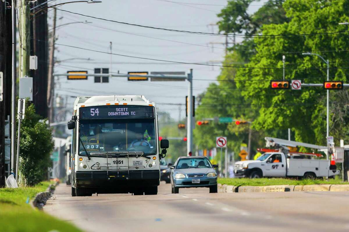 The 54 bus travels north up Scott Street, Thursday, March 26, 2020, near the University of Houston. Metro is planning to add Wi-Fi to the route.