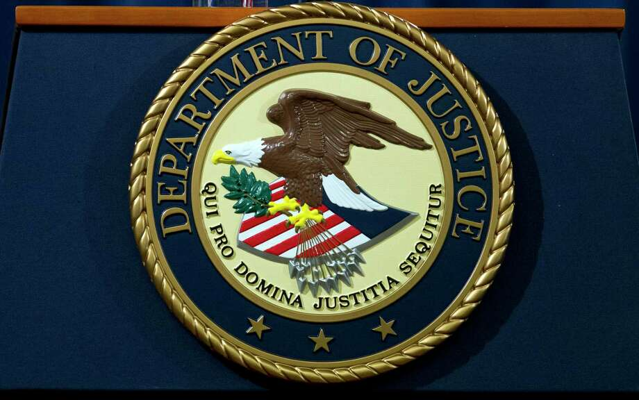 FILE - In this Nov. 28, 2018, file photo, the Department of Justice seal is seen in Washington, D.C. An internet firm is ending the automated registration of website names that include words or phrases related to the COVID-19 pandemic, in an attempt to combat coronavirus-related fraud. Los Angeles-based Namecheap Inc. made the pledge after a federal judge in Texas on Sunday, March 22, 2020, ordered the takedown of a website the U.S. Department of Justice accused of stealing credit card information while offering fake coronavirus vaccine kits. (AP Photo/Jose Luis Magana, File) Photo: Jose Luis Magana, FRE / Associated Press / Copyright 2018 The Associated Press. All rights reserved